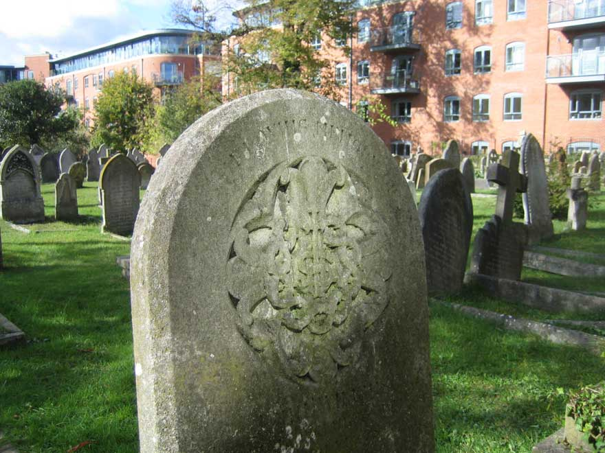 Grave overlooked by flats
